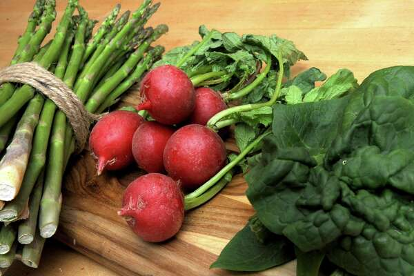 Asparagus, radish and Spinach is seen on a kitchen countertop in Caroline Barrett's home on Monday, May 2, 2016 in Delmar, N.Y. (Lori Van Buren / Times Union)