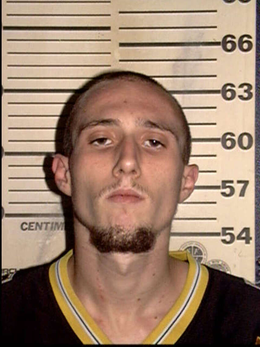 Anthony Ray Mari, seen in this booking photo from 2003, has been charged with three counts of aggravated robbery.