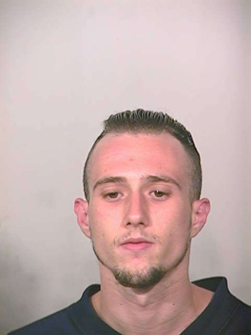 Anthony Ray Mari, seen in this booking photo from 2004, has been charged with three counts of aggravated robbery.