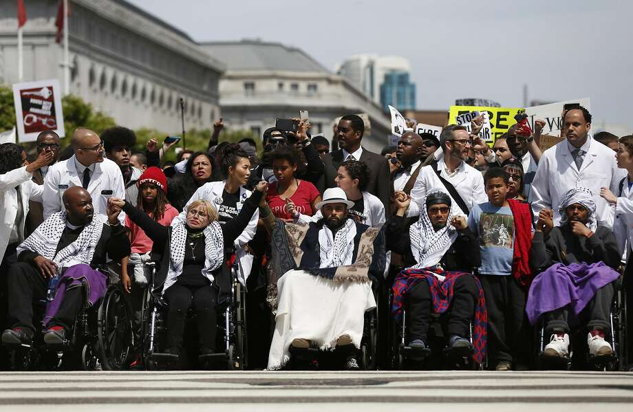 Hunger strikers arrive at City Hall in wheelchairs Tuesday. Photo: Leah Millis, The Chronicle