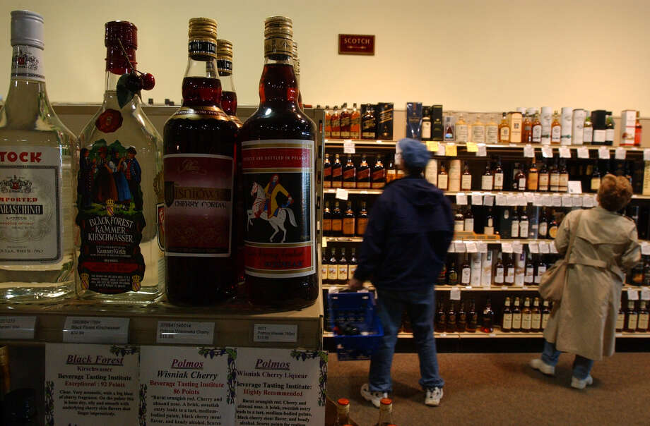 Times Union staff photo by Paul Buckowski --- Two unidentified customers shop for liquor at All Star Wine & Spirits in Latham, on Sunday May 25, 2003.  Sunday was the first Sunday that liquor stores could be open under a new state law. Photo: PAUL BUCKOWSKI / ALBANY TIMES UNION