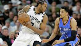Spurs' Kawhi Leonard positions against Oklahoma City Thunder's Andre Roberson during the first half in Game 2 of a second-round NBA playoff series on May 2, 2016, in San Antonio.