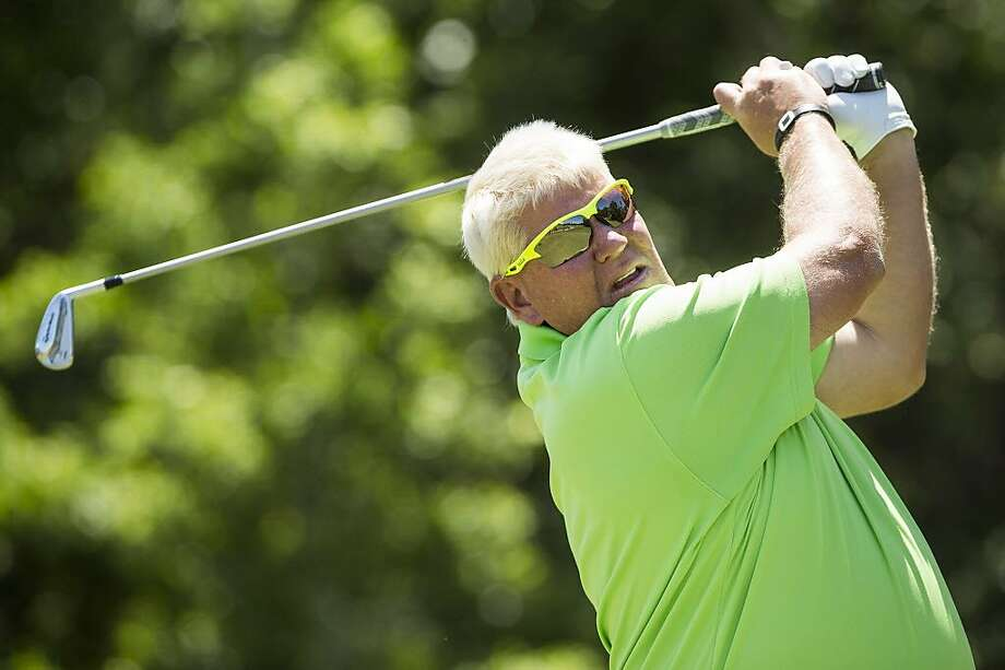 John Daly tees off Wednesday during a Champions Tour pro-am at The Woodlands. Daly will make his Champions Tour debut this week. Photo: Brett Coomer, Houston Chronicle