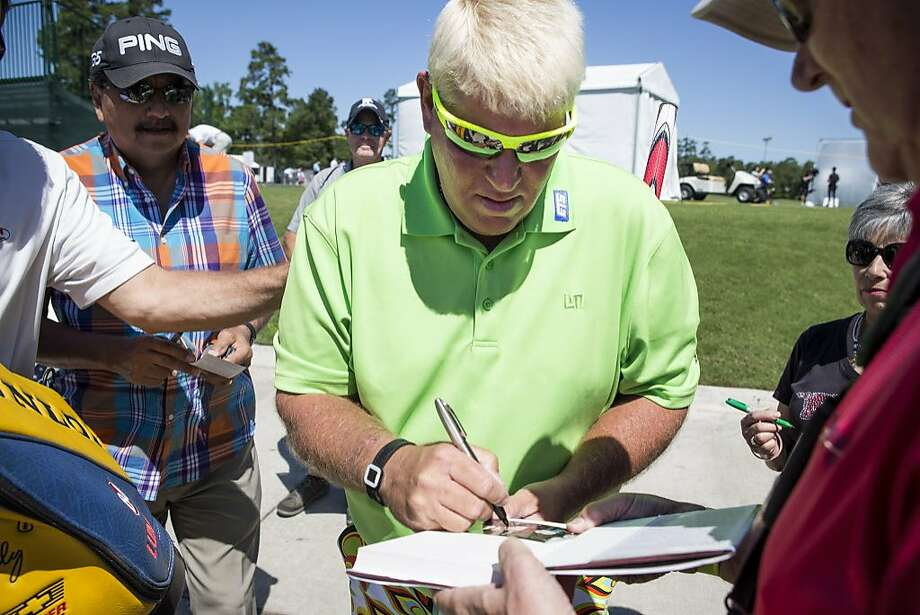 John Daly signs autographs before participating in the PGA TOUR Champions Insperity Invitational Pro-Am on Wednesday, May 4, 2016, in The Woodlands. Daly, who recently turned 50, makes his PGA TOUR Champions debut at the Insperity Invitational. ( Brett Coomer / Houston Chronicle ) Photo: Brett Coomer, Houston Chronicle