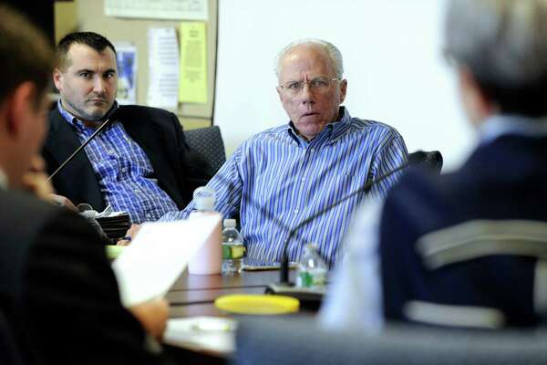 Matt Grimes, left, former chairman of the Republican Town Committee in Brookfield and Thomas Dunkerton, Republican registrar, listen during Jane Miller's hearing in her request to be reinstated in the Republican party, Monday, April 18, 2016.