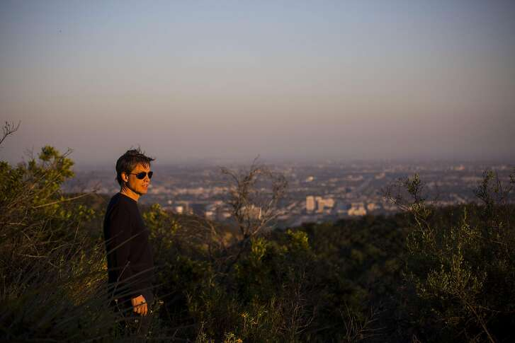 Nicholas Berggruen looks west at the sunset from atop a peak on the 450 acres he purchased in the Sepulveda Pass on April 15, 2016. Berggruen plans to build his non-partisan think tank, the Berggruen Institute, on the land. (Jay L. Clendenin/Los Angeles Times/TNS)