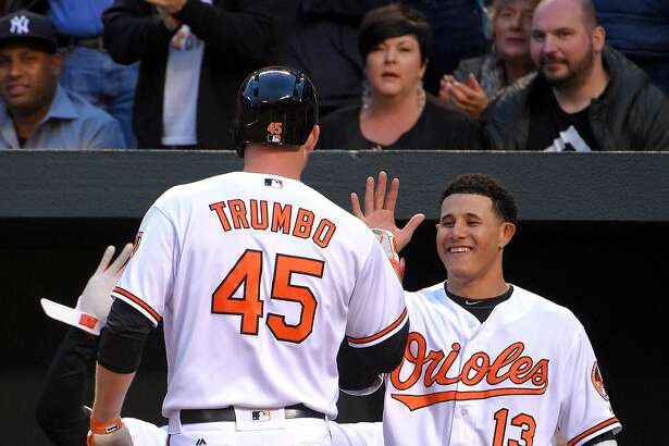 The Baltimore Orioles' Manny Machado (13) congratulates Mark Trumbo after he hit a solo home run in the second inning against the New York Yankees on Tuesday, May 3, 2016, at Oriole Park at Camden Yards in Baltimore. The Orioles won, 4-1. (Karl Merton Ferron/Baltimore Sun/TNS)