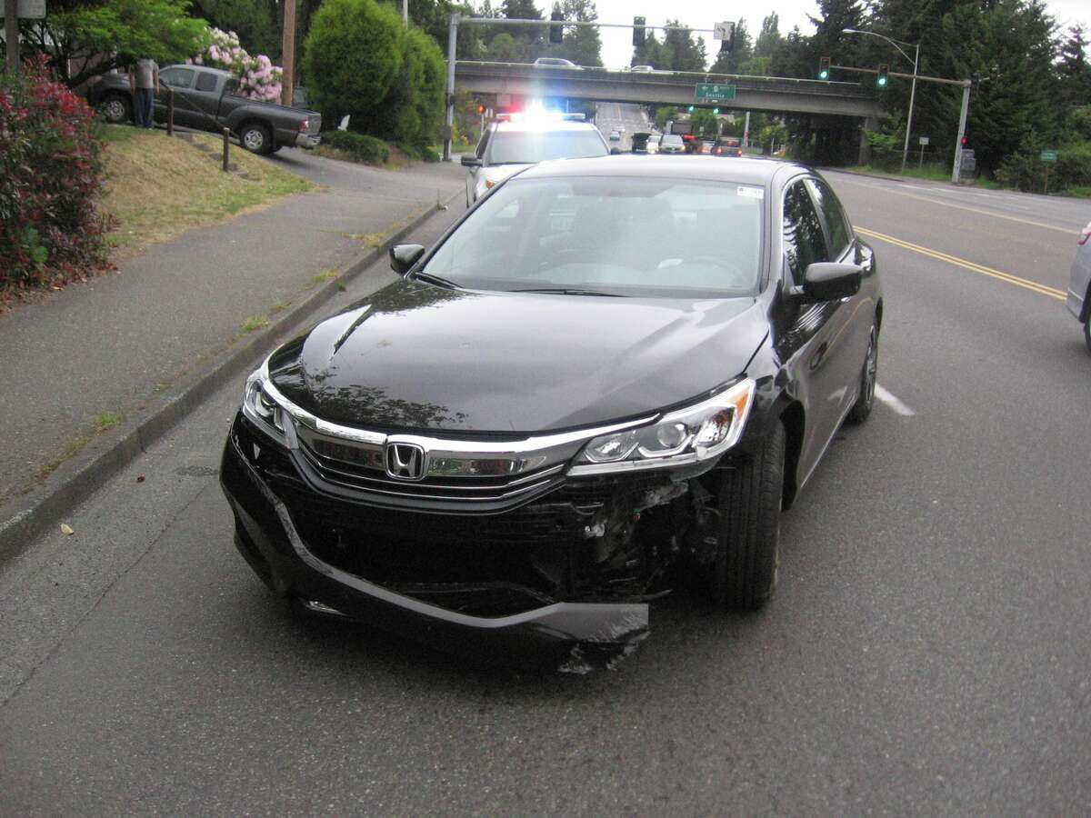 Burien police detained a man carrying his pet monkey Wednesday morning after he was clocked at 112 mph on state Route 509 and crashed his car in Burien.