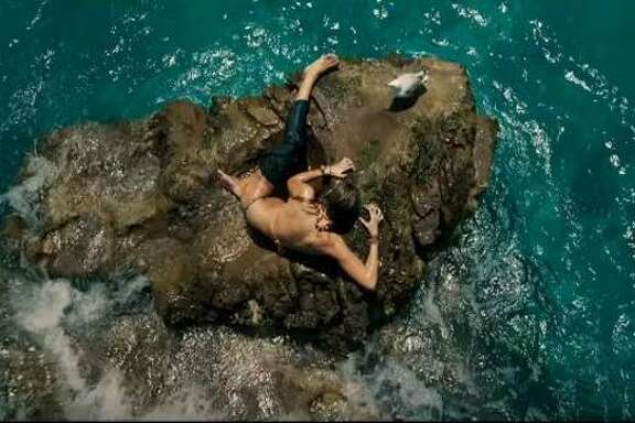 """Blake Lively plays a surfer trapped on a rock by a circling shark in """"The Shallows."""""""
