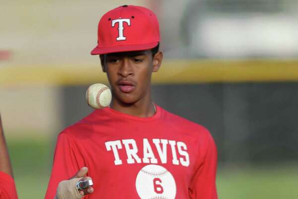 Travis freshman baseball player Trey Faltine, who recently committed to Texas despite not being able to sign until Nov. 2019 at the earliest. It's for a story on athlete committing earlier and earlier. Faltine, who is injured and his team traveled to play Stephen F. Austin Tuesday, March 22, 2016, in Sugar Land. ( Steve Gonzales  / Houston Chronicle  )