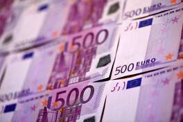 (FILES) This file photo taken on February 12, 2016 shows several 500 Euro notes displayed in an arrangement.  The European Central Bank (ECB) said on May 4 it would no longer produce and issue 500 euro banknotes, amid fears that the purple-coloured bills were favoured by criminals for money laundering and even terrorist financing.  / AFP PHOTO / MIGUEL MEDINAMIGUEL MEDINA/AFP/Getty Images