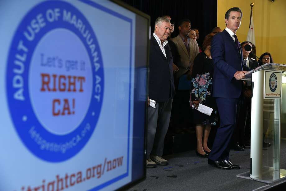 Lt. Gov. Gavin Newsom speaks at a news conference in San Francisco, Calif. on Wednesday, May 4, 2016 to announce the Adult Use of Marijuana Act has qualified for the November ballot. Joining Newsom on the stage at left is Rep. Dana Rohrabacher (R-Costa Mesa). Photo: Paul Chinn, The Chronicle
