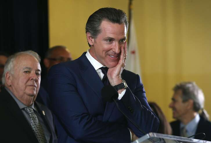 Lt. Gov. Gavin Newsom listens as members of a bipartisan coalition of supporters speak at a news conference in San Francisco, Calif. on Wednesday, May 4, 2016 to announce the Adult Use of Marijuana Act has qualified for the November ballot.
