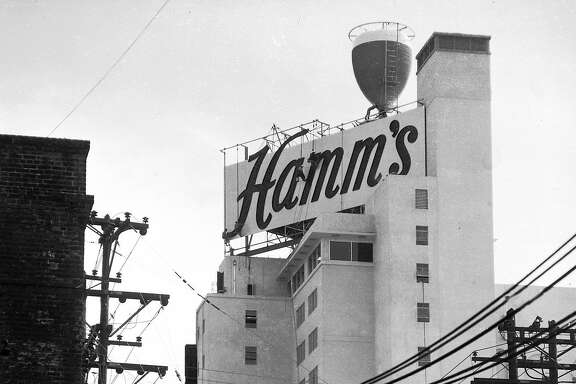 "June 24, 1954: If you were a kid in the 1950s, 1960s or 1970s, this Hamm's Brewery sign at 1550 Bryant Street was likely your happy place. The chalice at the top had neon lights that made the glass look like it was ""filling up"" with beer at night, visible from the Central Freeway on the way to Noe Valley, the Castro and beyond. This photo was taken in 1954, when the Hamm's chalice was replacing the Rainier Brewery sign. (Look closely, and you can see workers on scaffolding.) Longtime Chronicle photographer Bob Campbell, an overseas photographer during World War II, was sent to take photos of the new sign - and took six from different angles throughout the city. The Hamm's sign was taken down in 1975."