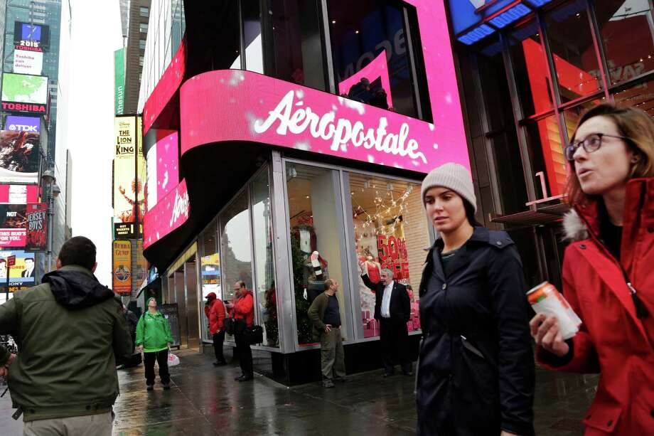 FILE - In this Wednesday, Dec. 2, 2015, file photo, women pass an Aeropostale clothing store in New York's Times Square. Aeropostale, once the vibrant epicenter of the U.S. mall scene, announced Wednesday, May 4, 2016, it is seeking Chapter 11 bankruptcy protection. (AP Photo/Mark Lennihan, File) ORG XMIT: NYBZ346 Photo: Mark Lennihan / Copyright 2016 The Associated Press. All rights reserved. This m