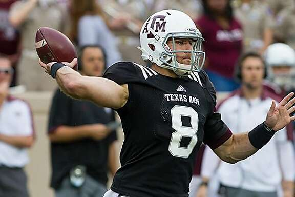 Quarterback Trevor Knight, a former Reagan standout, passes during Texas A&s spring game on April 9, 2016 at Kyle Field in College Station.