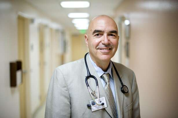 Dr. Howard Kornfeld poses for a portrait in a hallway of the pain clinic at Highland General Hospital in Oakland, CA on Tuesday May 28th, 2013.