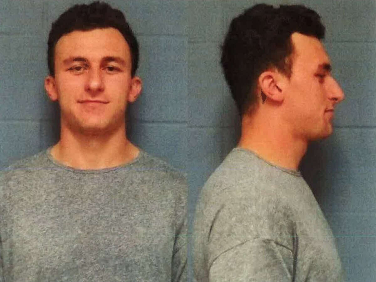Johnny Manziel turned himself in to authorities Wednesday on a misdemeanor domestic violence charge.