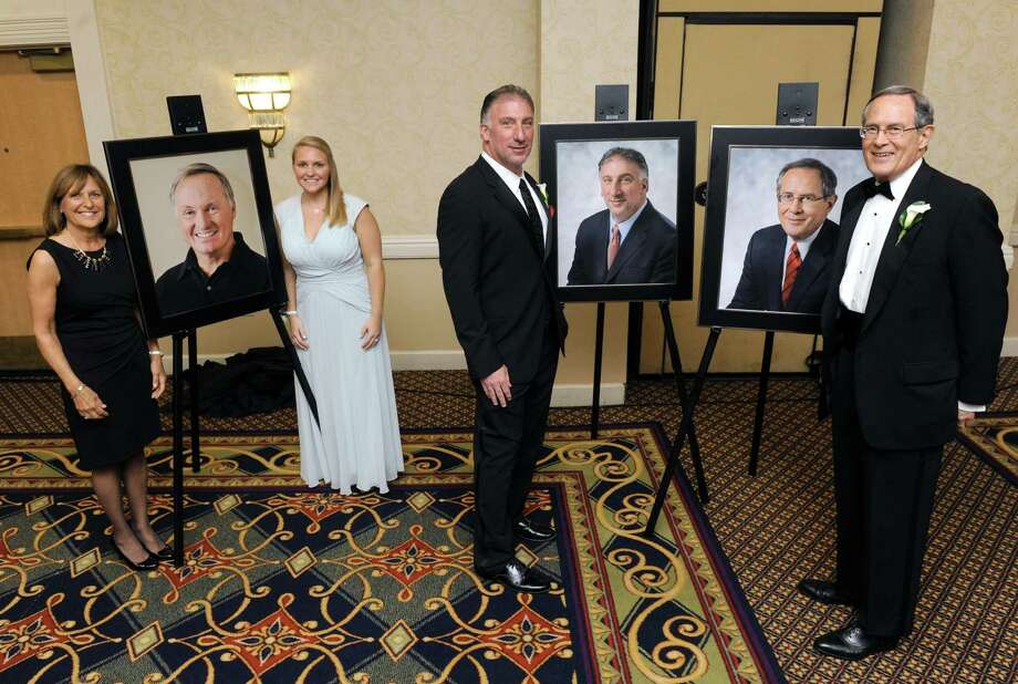 Three people were inducted into the 2016 Tech Valley Business Hall of Fame. Here, Sheila Michael, left, with her daughter Katie Early stand with a  portrait of inductee John H. Michaels (1957-2014), principal of The Michaels Group; inductee Michael J. Castellana, center, president & CEO SEFCU and inductee E. Stewart Jones Jr., partner in E. Stewart Jones Hacker Murphy on Wednesday May 4, 2016 in Colonie, N.Y. (Michael P. Farrell/Times Union) Photo: Michael P. Farrell / 10036243A