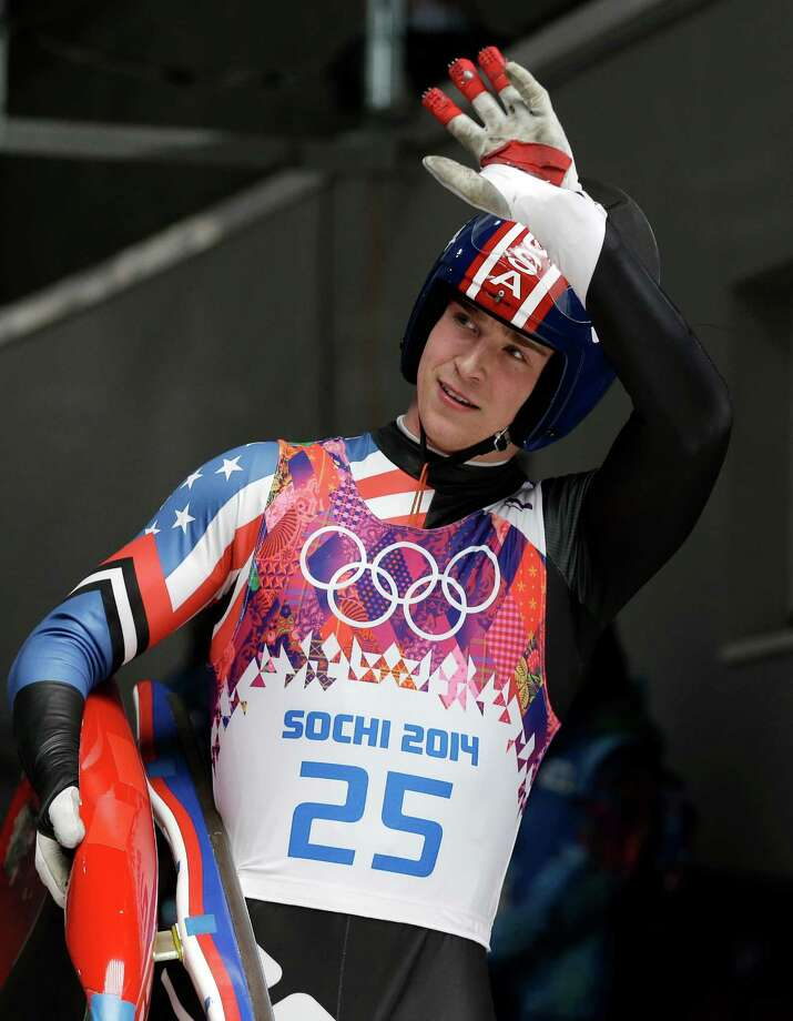 Tucker West of the United States waves to supporters in the finish area during the men's singles luge final at the 2014 Winter Olympics, Sunday, Feb. 9, 2014, in Krasnaya Polyana, Russia. (AP Photo/Natacha Pisarenko) Photo: Natacha Pisarenko / Associated Press / AP