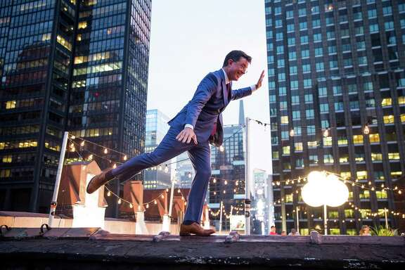 FILE -- Steven Colbert on the roof of the Ed Sullivan Theater in New York, Aug. 24, 2015.