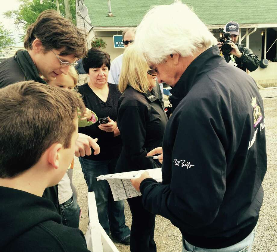 Seems like anyone who wandered by trainer Bob Baffert's barn at Churchill Downs Wednesday morning had some kind of American Pharoah memorabilia for him to sign. And he was more than accommodating. He signed programs and hats, even some American Pharoah liquor bottles. Hard to believe it's already been a year since Pharoah started his  magical run by winning the 2015 Kentucky Derby.  —Tim Wilkin
