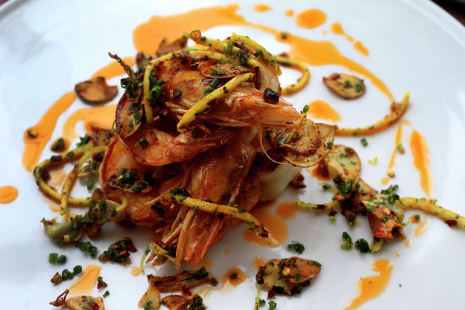 The classic Spanish dish gambas (shrimp) a la plancha with slivers of toasted garlic is a standout on the menu of Edera Osteria Enoteca. Photo: Photos By John Davenport /San Antonio Express-News / ©San Antonio Express-News/John Davenport