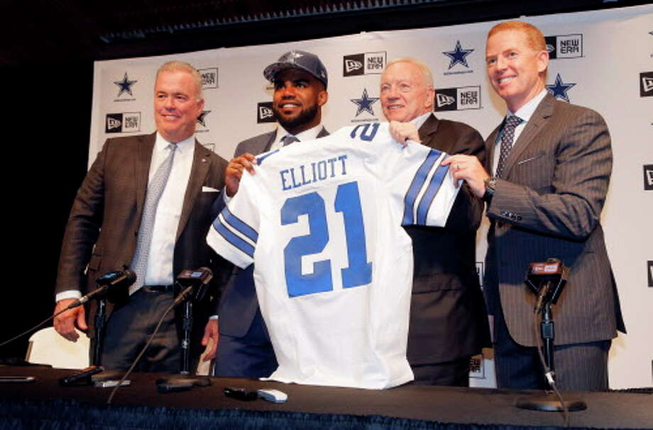 The Dallas Cowboys NFL football first round draft pick Ezekiel Elliott, second from left, poses for photos with his new jersey and Director of Player Personnel Stephen Jones, from left, team owner Jerry Jones, center, head coach Jason Garrett, right, after a news conference at the team's training facility, Friday, April 29, 2016, in Irving, Texas. (AP Photo/Tony Gutierrez) Photo: Associated Press