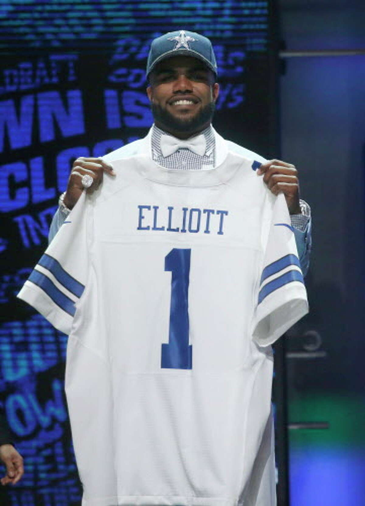 Ohio State?'s Ezekiel Elliott poses for photos after being selected by Dallas Cowboys as the fourth pick in the first round of the 2016 NFL football draft, Thursday, April 28, 2016, in Chicago. (AP Photo/Charles Rex Arbogast)