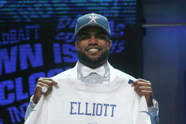 Ohio State's Ezekiel Elliott poses for photos after being selected by Dallas Cowboys as the fourth pick in the first round of the 2016 NFL football draft, Thursday, April 28, 2016, in Chicago. (AP Photo/Charles Rex Arbogast)