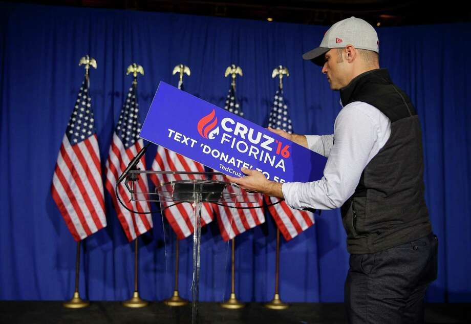 A worker for Republican presidential candidate Sen. Ted Cruz, R-Texas, removes the campaign sign from the podium following primary night campaign event in Indianapolis, Tuesday, May 3, 2016. Cruz ended his presidential campaign, eliminating the biggest impediment to Donald Trump's march to the Republican nomination. Photo: Michael Conroy, Associated Press / Copyright 2016 The Associated Press. All rights reserved. This material may not be published, broadcast, rewritten or redistribu