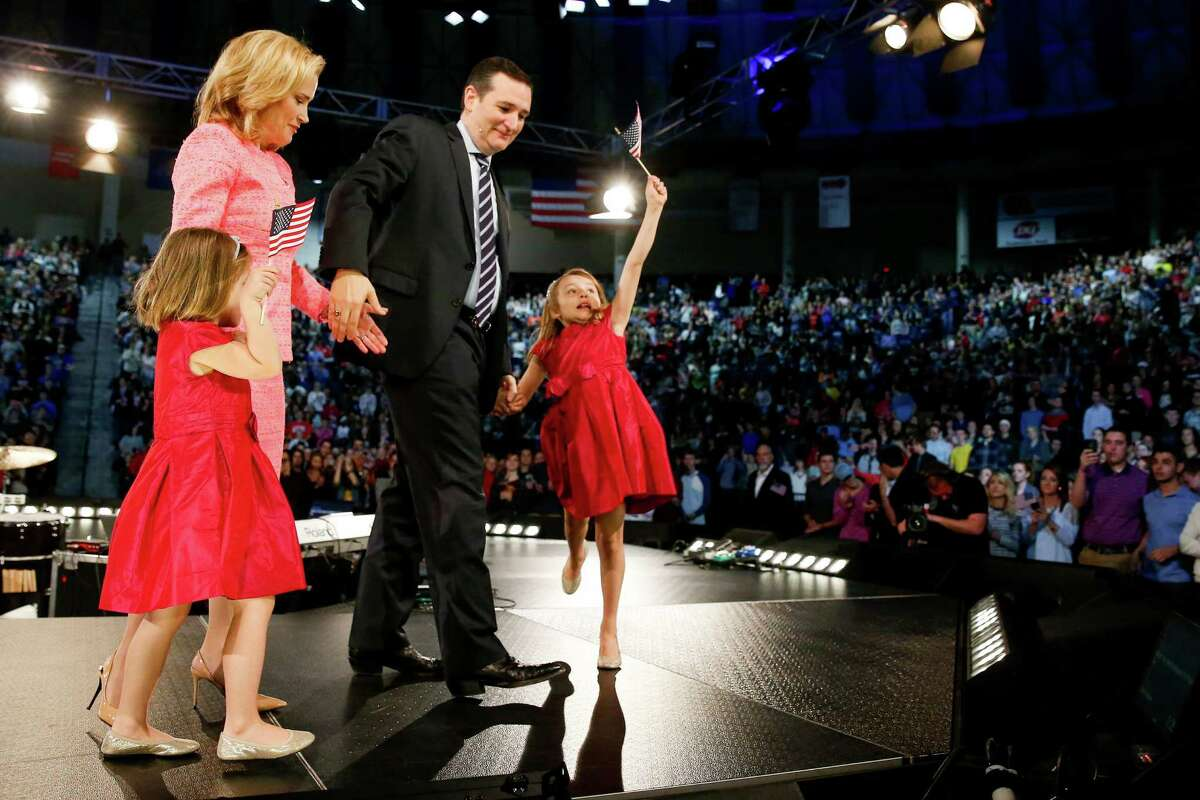 Caroline Cruz, 6, right, waves an American flag after she joins her father, Sen. Ted Cruz, R-Texas on stage, with his wife Heidi, and their other daughter Catherine, 4, left, as Cruz announces his campaign for president. Monday, March 23, 2015, at Liberty University, founded by the late Rev. Jerry Falwell, in Lynchburg, Va. Cruz, who announced his candidacy on twitter in the early morning hours, is the first major candidate in the 2016 race for president.