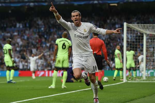 Real Madrid's Welsh forward Gareth Bale celebrates a goal during the UEFA Champions League semi-final second leg football match Real Madrid CF vs Manchester City FC at the Santiago Bernabeu stadium in Madrid, on May 4, 2016. / AFP PHOTO / PAUL ELLISPAUL ELLIS/AFP/Getty Images