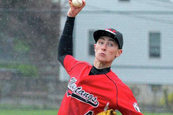 Fairfield Warde pitcher John Natoli delivers in the bottom of the fourth inning against Stamford in a FCIAC league game at Stamford High School on May 4, 2016. Warde defeated Stamford 3-1.