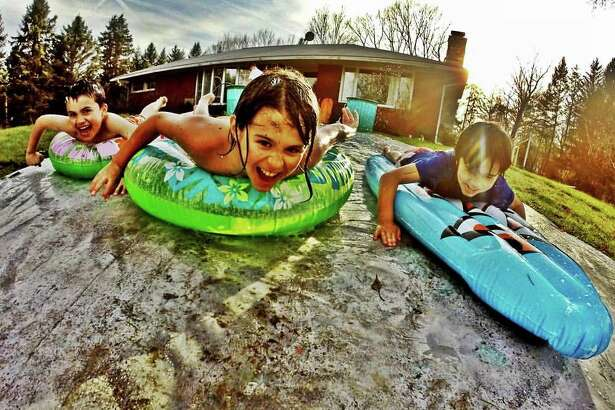 Rebecca Dee snapped a close-up of her son and his buddies enjoying themselves on a gigantic slip during the run-up to spring break at the Hirokawa's home in Wynantskill. Seen are Carter Dee of Averill Park and Owen and Ethan Hirokawa of Wynantskill. (Rebecca Dee)