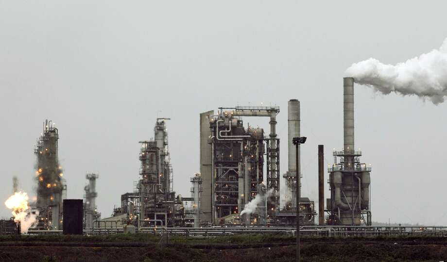 The newly formed Climate Leadership Council is proposing elimination of nearly all of the Obama administration's climate policies in exchange for a rising carbon tax that starts at $40 per ton. Proceeds would be used to pay quarterly dividends to American taxpayers. They said the payments would amount to about $2,000 total each year for families. Photo: Associated Press /File Photo / Copyright 2016 The Associated Press. All rights reserved. This material may not be published, broadcast, rewritten or redistribu