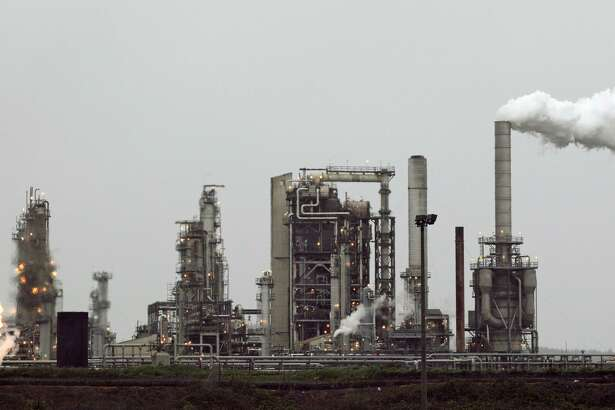 FILE - This April 2, 2010, file photo, shows a Tesoro Corp. refinery, including a gas flare flame that is part normal plant operations, in Anacortes, Wash. The San Antonio refiner reported first-quarter earnings Wednesday. (AP Photo/Ted S. Warren, File)