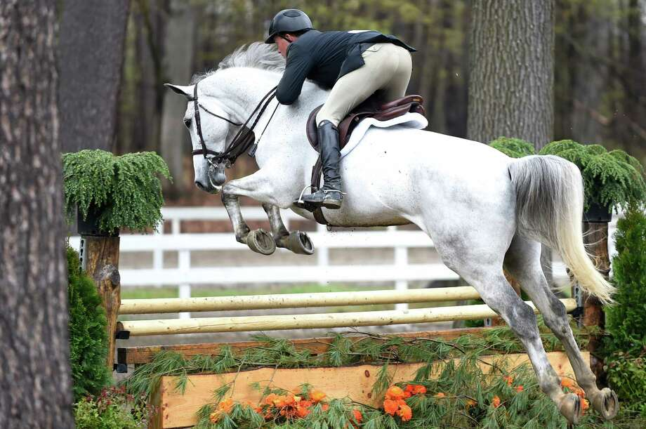 A rider guides his mount over a jump during the Saratoga Springs Horse Show on Wednesday, May 4, 2016, at the Yaddo Show Grounds in Saratoga Springs, N.Y. The show, operated by The Capital Fund of Saratoga, runs Wednesdays through Sundays to May 22 from 8:00 a.m. until late afternoon and includes hunter, jumper and pony classes. (Cindy Schultz / Times Union) Photo: Cindy Schultz / Albany Times Union