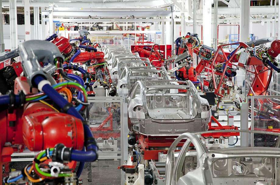 Model S sedans being built at the Tesla Motors factory in Fremont. Tesla may open a factory in China if the companyÕs electric luxury cars sell well there. Photo: Handout, Courtesy Tesla
