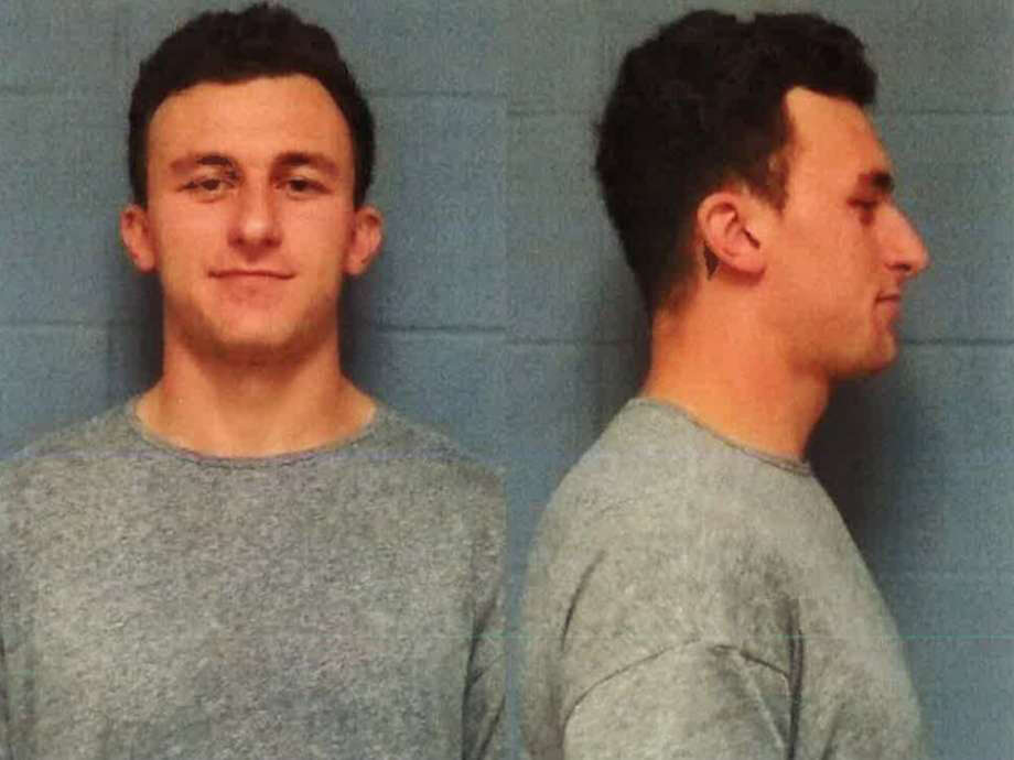 Johnny Manziel had to pose for photos Wednesday he would have preferred to avoid.