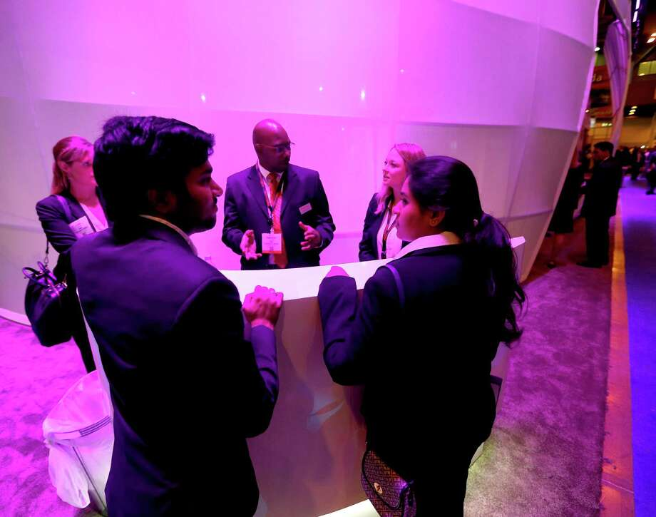 UH students Himavath Reddy Goguri, left, and Srujana Panchakarla leave résumés at the FMC Technologies booth. Photo: Karen Warren, Staff / © 2016 Houston Chronicle