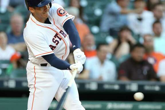 Houston Astros shortstop Carlos Correa (1) connects for an RBI double in the first inning. Photos of game three between Houston Astros and Minnesota Twins on Wednesday, May 4, 2016, in Houston. The series is tied 1-1.