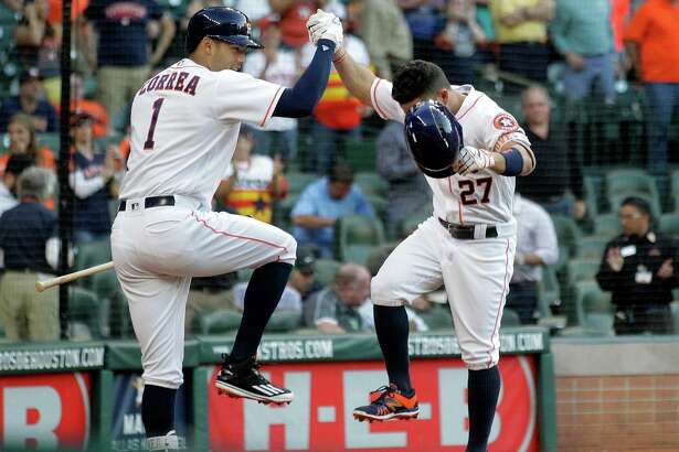 Houston Astros shortstop Carlos Correa (1) and Houston Astros second baseman Jose Altuve (27) celebrate Altus's solo home run in the first inning making the score 1-0. Photos of game three between Houston Astros and Minnesota Twins on Wednesday, May 4, 2016, in Houston. The series is tied 1-1.