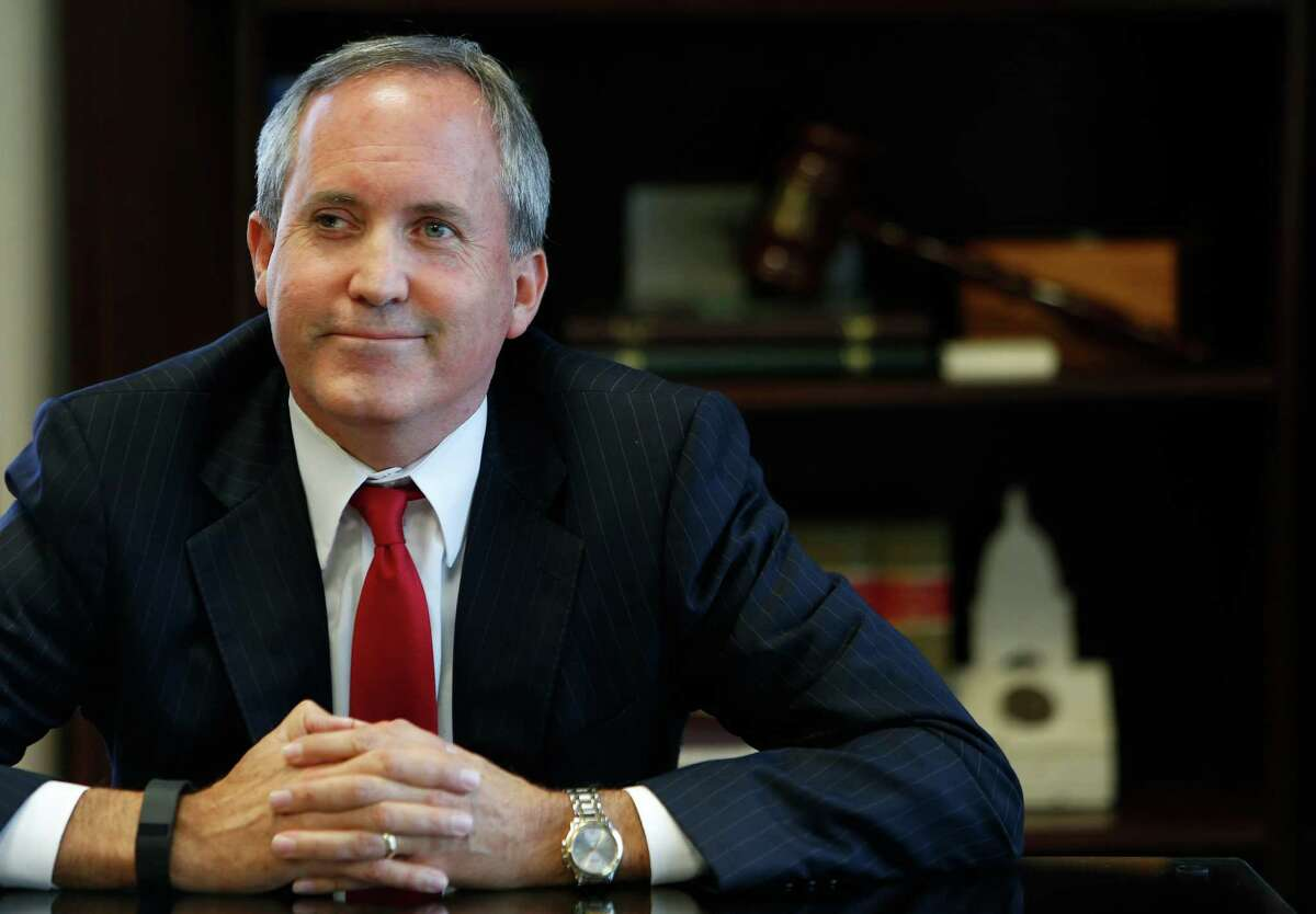 Texas Attorney General Ken Paxton, left, and Land Commissioner George P. Bush said they would follow the governor's directive.