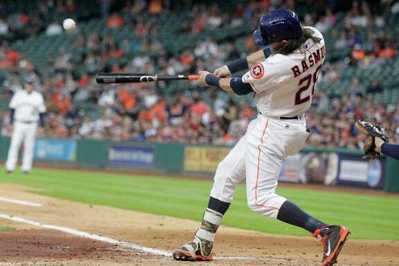 Houston Astros left fielder Colby Rasmus (28) connects for and RBI single that brings in Houston Astros right fielder George Springer (4) int he bottom of the second inning. Photos of game three between Houston Astros and Minnesota Twins on Wednesday, May 4, 2016, in Houston. The series is tied 1-1.