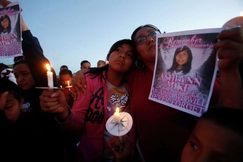 Klandre Willie, left, and her mother, Jaycelyn Blackie, participate in a candlelight vigil Tuesday for Ashlynne Mike at the San Juan Chapter House in Lower Fruitland, N.M. Photo: Jon Austria/The Daily Times, MBO / The Daily-Times