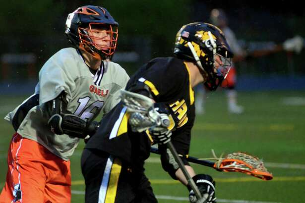 Shelton's Stephen Willey, left, blocks Daniel Hand's Mike Bartosic during boys lacrosse action in Shelton, Conn., on Wednesday May 4, 2016.