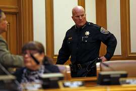 San Francisco Police Chief Greg Suhr leaves SF Police Commission meeting after protesters disrupted meeting at City Hall in San Francisco, Calif., on Wednesday, May 4, 2016.