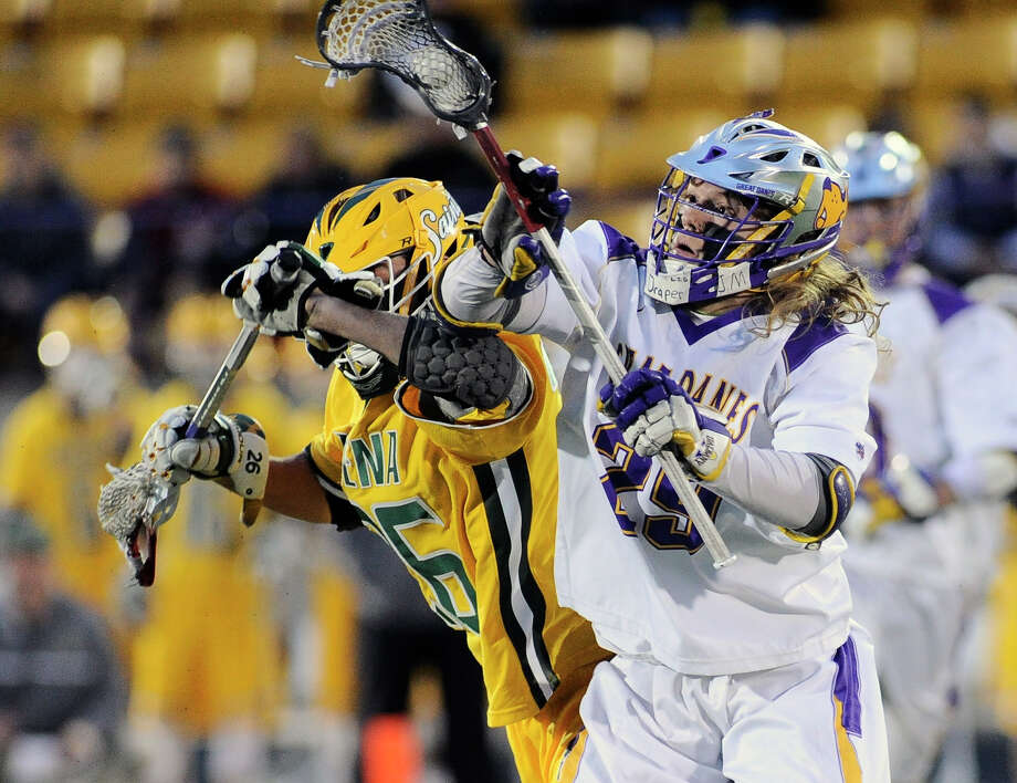 UAlbany's Zack Ornstein ,right, wins a face-off with Siena's Tyler Pantalone (26)   during an NCAA Division I college men's lacrosse game on Tuesday, April 26, 2016, in Albany, N.Y. (Hans Pennink / Special to the Times Union) ORG XMIT: HP104 Photo: Hans Pennink / Hans Pennink