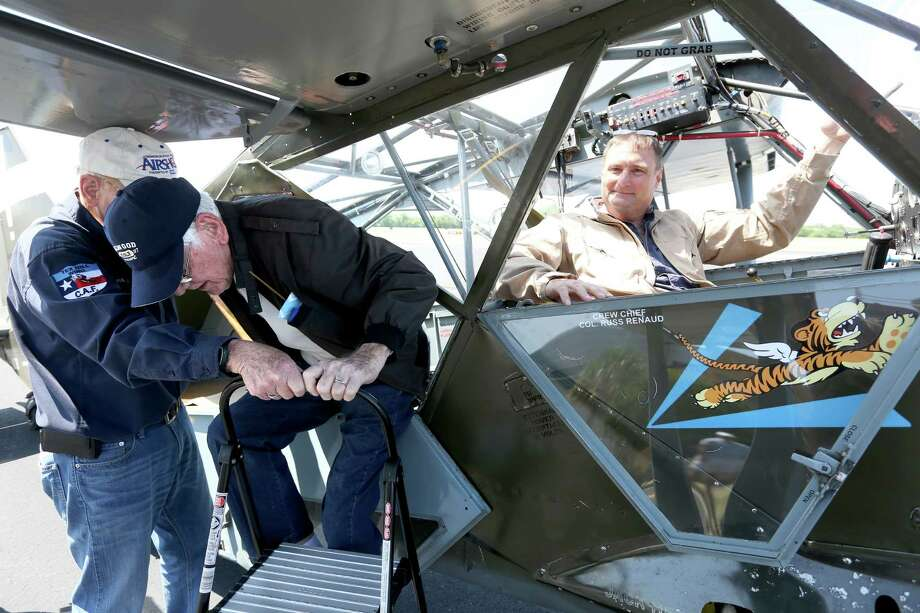 William Waterman, right, exists a Stinson L5-C from the Tex Hill wing of the Commemorative Air Force from Hondo after he took a flight with pilot Darren Bond at Stinson Airport. Photo: William Luther, Staff / San Antonio Express-News / © 2016 San Antonio Express-News